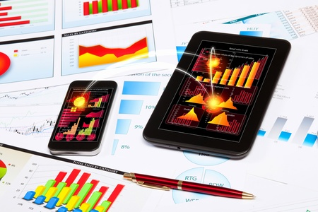 portable information device: Image of touchpad and mobile phone with diagrams Stock Photo
