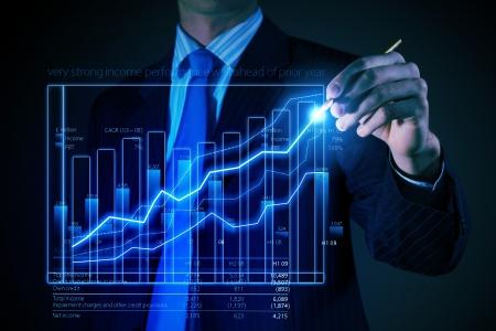 increment: Closeup image of businessman drawing 3d graphics