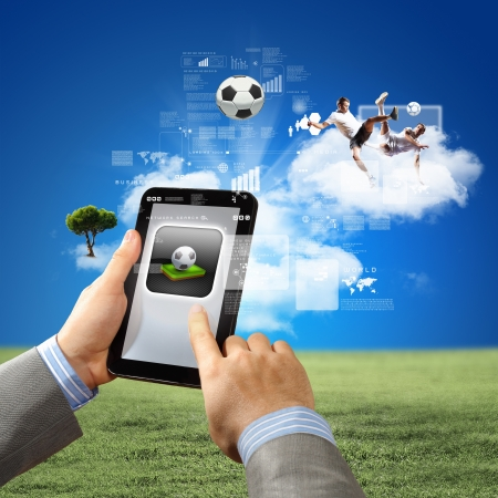 man s: Close-up image of man s hands holding tablet pc with picture of ball Stock Photo