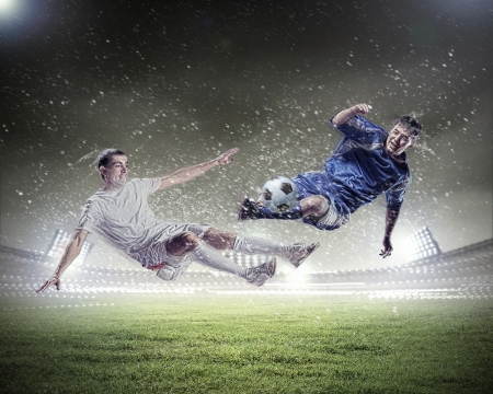 soccer kick: Image of two football players at stadium Stock Photo
