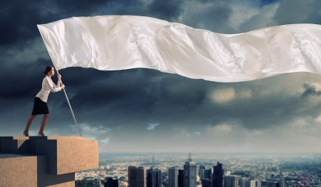 pr: Image of attractive businesswoman holding white flag  Place for text Stock Photo
