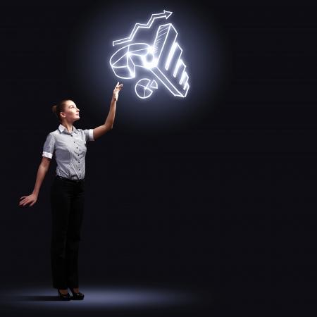 Image of attractive businesswoman against dark background photo