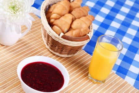 Continental breakfast with croisant and orane juice photo