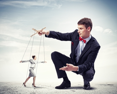 puppet: Image of young businessman puppeteer  Leadership concept Stock Photo