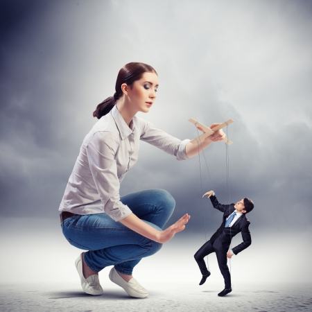 Image of pretty businesswoman puppeteer  Leadership concept Stock Photo - 20327508
