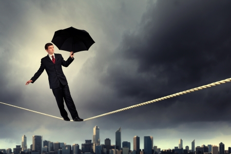 Image of pretty businessman balancing on rope Stock Photo - 20327343
