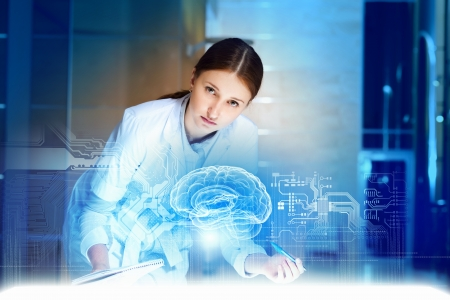 brain disease: Image of young woman doctor  Concept of modern technology Stock Photo