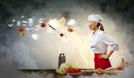 Asian female cook in anger with flyung vegetables against color background with shine effects Stock Photo - 20327307