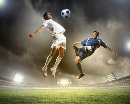 football fan: Image of two football players at stadium Stock Photo