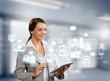 ハイテクの背景に対してタブレット pc と実業家のイメージ 写真素材