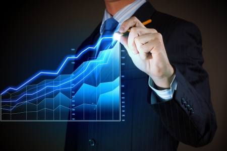 growth rate: Closeup image of businessman drawing 3d graphics