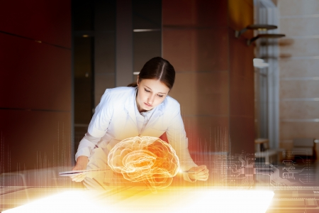 Image of young woman doctor  Concept of modern technology Stock Photo