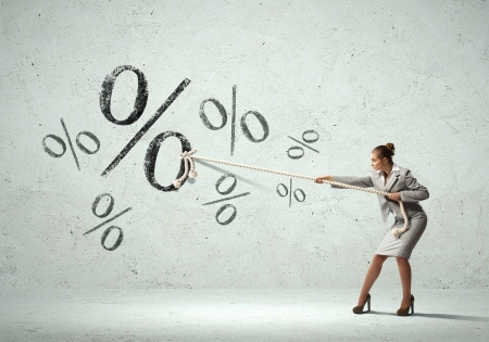 Image of attractive businesswoman pulling rope with percent sign