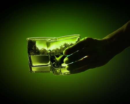 Two glasses of green absinth with nature illustration in illustration