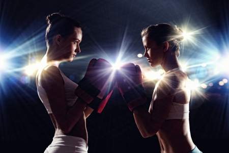 girl fighting: Two boxer women in gloves greet each other before fight
