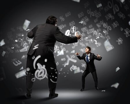 Image of businesspeople arguing and acting as sumo fighters Stock Photo