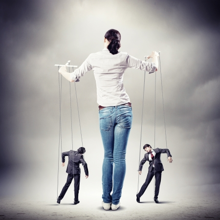 Image of pretty businesswoman puppeteer  Leadership concept photo