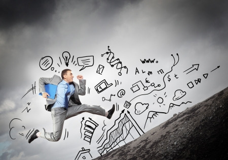 Image of jumping young businessman  Business collage Stock Photo