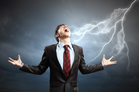 head ache: businessman in anger with fists clenched screaming Stock Photo