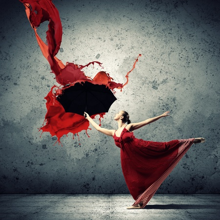 body paint: ballet dancer in flying satin dress with umbrella under the paint