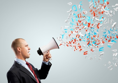 Image of angry businessman screaming in megaphone photo
