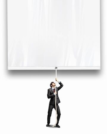 blank banner: Image of businessman pulling blank banner  Place for text