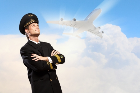 Image of male pilot with airplane at background Stock Photo - 20661855