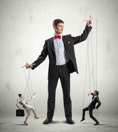 Image of young businessman puppeteer  Leadership concept Stock Photo - 20661861