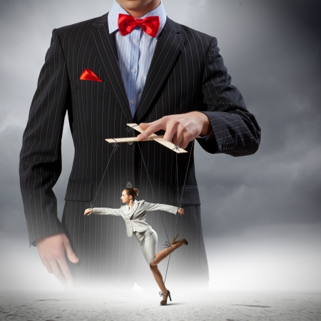 Image of young businessman puppeteer  Leadership concept Stock Photo - 20661862