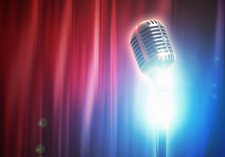 Let s sing  Stylish retro microphone on a colored background photo