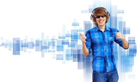 Happy smiling young man dancing and listening to music Stock Photo - 20661879