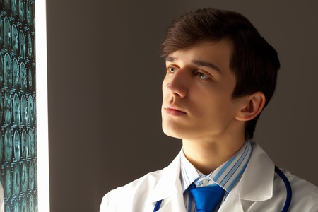 Image of male doctor looking at x-ray results photo