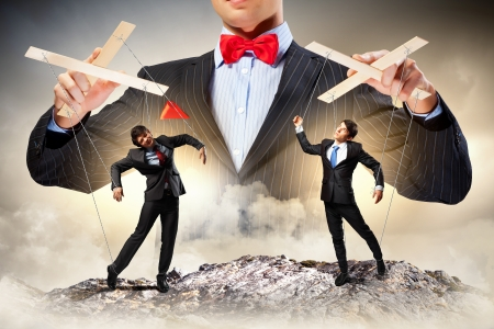 Image of young businessman puppeteer  Leadership concept Reklamní fotografie