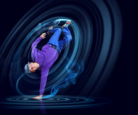 Modern style dancer posing against dark background with light effects  Illustration photo