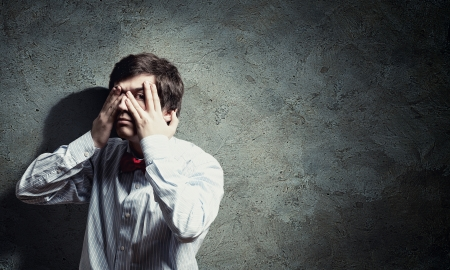 Handsome businessman closing his eyes with palms Stock Photo - 21001026