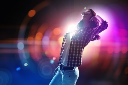 young people party: Young girl listens to music  Modulations of color and light