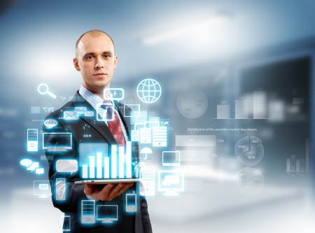 screen: Image of businessman with tablet pc against high-tech background