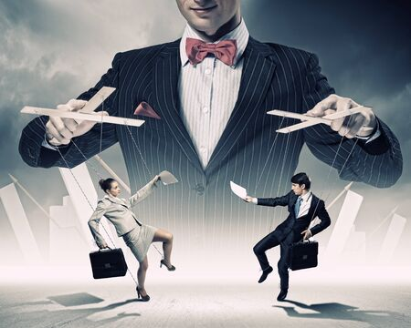 pr: Image of young businessman puppeteer  Leadership concept Stock Photo