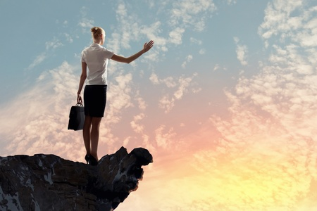 marketresearch: Image of businesswoman standing on top of hill