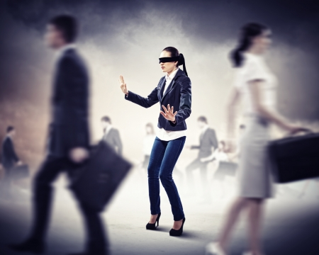 blind people: Image of businesswoman in blindfold walking among group of people