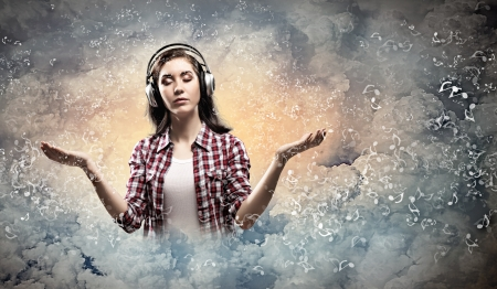 Image of young pretty woman with headphones meditating photo