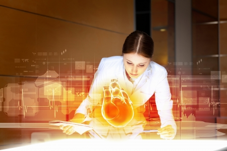 pulmology: Image of attractive woman cardiologist examining virtual heart
