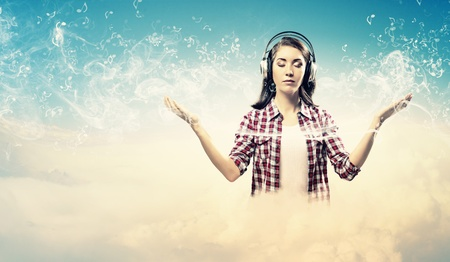 eyesclosed: Image of young pretty woman with headphones meditating Stock Photo
