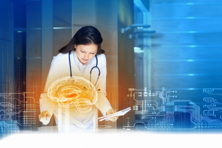 futuristic interface: Image of young woman doctor  Concept of modern technology Stock Photo