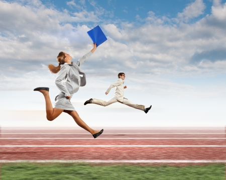 Image of business people running on tracks  Competition concept photo