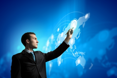 business communication: Image of young businessman touching icon of media screen