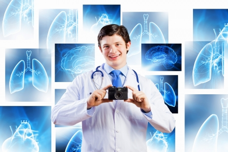 funny doctor: Young funny doctor taking photos with camera
