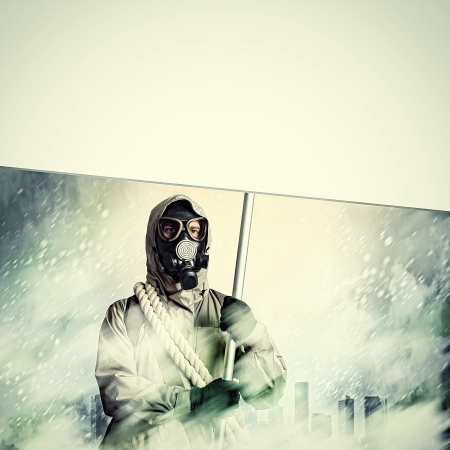 Stalker in gas mask with blank banner  Disaster concept Stock Photo - 21186879
