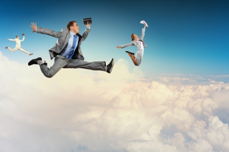 excited man: Image of businesspeople jumping high in sky