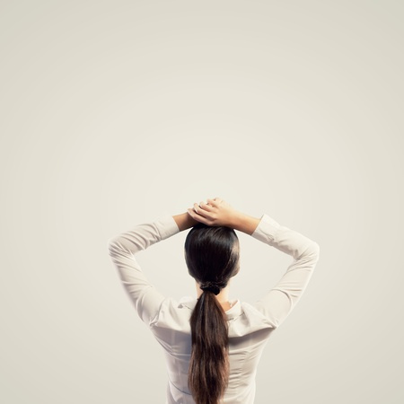 arms above head: Image of young woman standing with her back with arms above head  Place for text